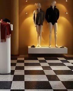 Butik med hvid og sort ternet gulv